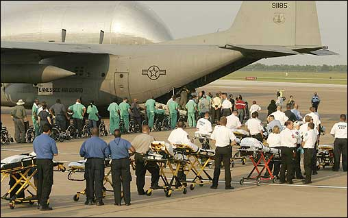 Emergency personnel waited to accept 23 patients from the Veterans Administration Hospital in New Orleans upon arrival on a Tennessee Air National Guard transport plane Thursday in Houston, Texas.