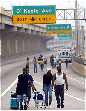 Hurricane Katrina survivors walked along Interstate 10 Thursday in New Orleans.