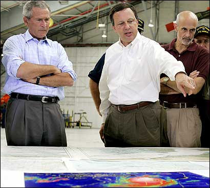 President Bush, Homeland Security head Michael Chertoff (second from right), and FEMA chief Michael Brown (center).
