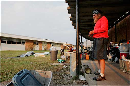 Cass Smith stood near his sleeping area Monday at a makeshift shelter setup in Bay High School in Bay St. Louis, Miss., after his home was destroyed.