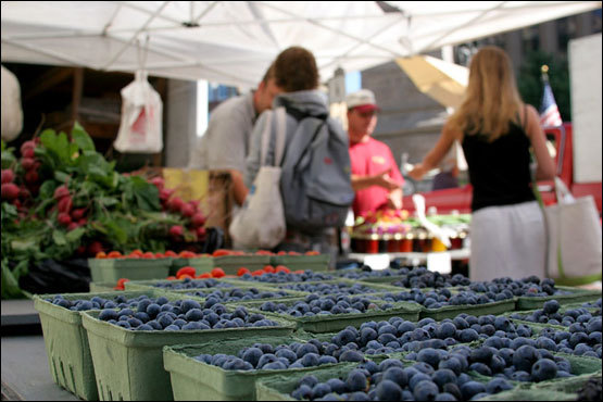 Portland's Monument Square attracts a number of farmers bringing local produce downtown in the summer. For a perfect mid-day snack, purchase a carton of fresh Maine blueberries here.