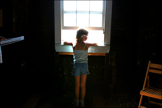 The Portland Observatory was constructed for use as a maritime signal house to aid the dock workers in preparation for arriving ships. A young girl looks out of one of the observatory's windows half way up the tower.