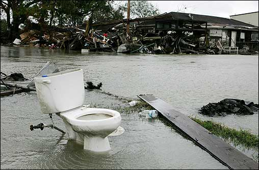 A toilet sat in water coming from a breach in the repaired Inner Harbor Canal Friday as water flowed toward houses in the Ninth Ward.