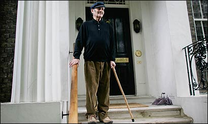 Harold Pinter, using a cane after a recent fall, talked to reporters outside his home.