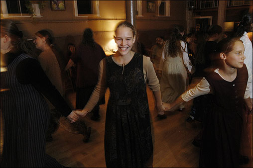 Twelve Tribes members, including Lavah Howley (center), dance and dine together on Friday nights in Plymouth.