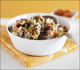 Dotted with dried fruits and almonds, basmati rice is cooked in a pilaf with chicken stock.