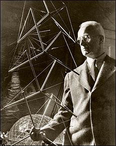 Buckminster Fuller, circa 1950, holding a 'tensegrity mast.'