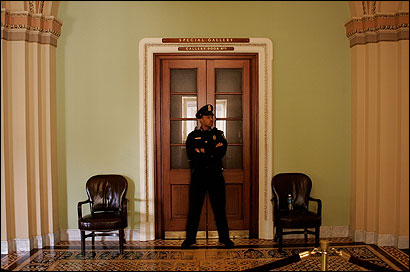 A Capitol Police officer stood outside the Senate Chamber yesterday after minority leader Harry Reid called for a closed-door session to demand further investigation into prewar intelligence.