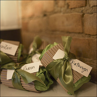 Gift-wrapped party favors await guests by the front door.