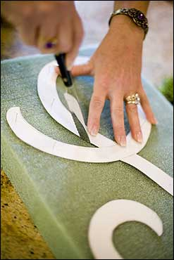 With straight pins, securely attach the template to a sheet of styrofoam. With a hot-wire foam cutter or a knife, cut the letter out of the styrofoam.