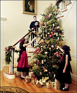 Trimming the tree in the foyer before a party are the host's son, Tyler, 14, and his cousins (from left) Samantha, 12, and Tarah, 10.