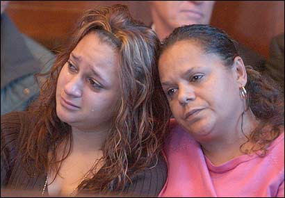 Jennifer Ramos (left), the daughter of the victim, cried as she sat with her aunt, Maria Ramos during the proceedings.