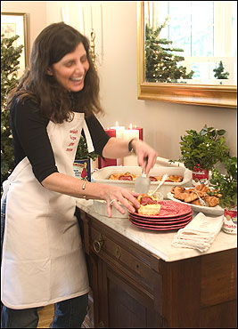 Deb Nicoletti at the buffet she adorned with large soup cans filled with fresh greenery.