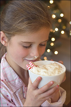 Breakfast treats include big cups of hot chocolate topped with lots of whipped cream and flavored with peppermint stirrers, a favorite of 9-year-old neighbor Cecily Docktor.