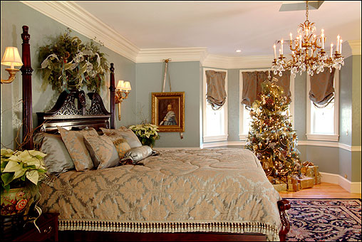 The gold and turquoise master bedroom and coordinating tree reflect the house's grand style.