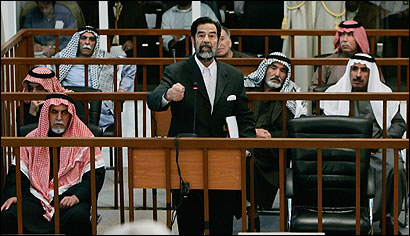With his fellow defendants seated nearby, Saddam Hussein addressed the court under tight security in Baghdad's Green Zone yesterday.