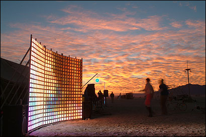 Tensor, a dazzling 8-by-10-foot wall of 64,800 multicolored LEDs, was created by Kevin McCormick. Some of McCormick's works were shown in local galleries.