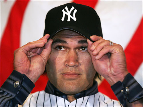 Dec. 23, 2005 Johnny Damon tried on his hat after being introduced as the Yankees' new center fielder.