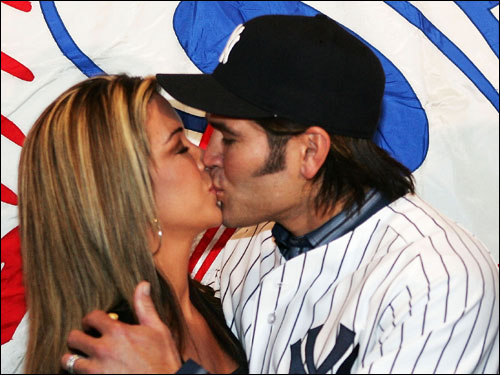 Johnny Damon kissed his wife Michelle at the press conference.