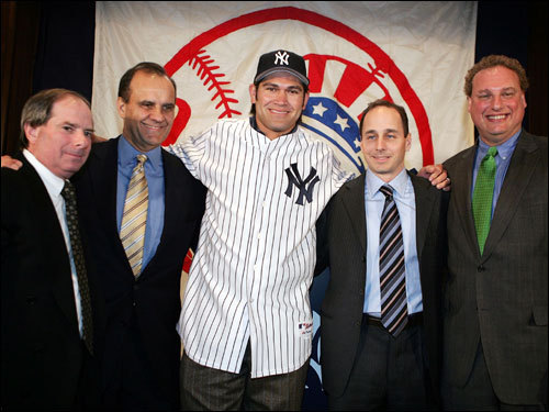 Damon (center) posed with (left to right) Lonn Trost, COO of the Yankees, manager Joe Torre, GM Brian Cashman and Randy Levine, president of the Yankees after being introduced at Yankee Stadium.