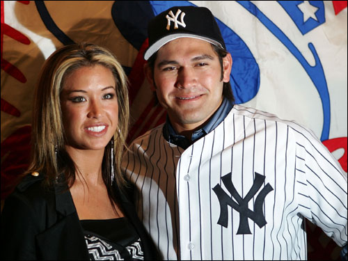 Johnny Damon of the New York Yankees posed with his wife Michelle after being introduced at Yankee Sta