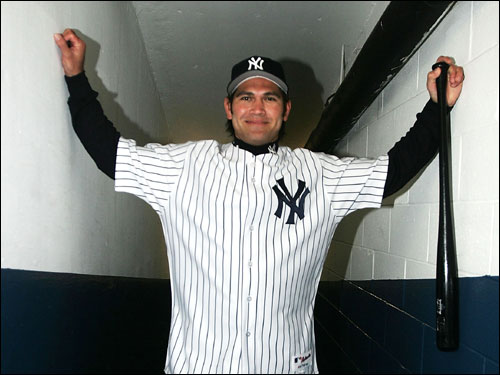 Damon posed in the Yankee Stadium tunnel leading out to the dugout after being introduced as the new