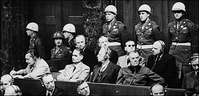 Nazi leaders, including Hermann Goering (front row, left, writing), on the third day of the Nuremberg trials.