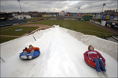 Jacob Dissinger and sister Kelsie enjoy tubing at Snow Magic Fun Park in a baseball stadium in Lancaster, Pa.
