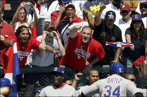 Fans celebrated after David Ortiz of the Dominican Republic hit a home run in the second inning against Venezuela.