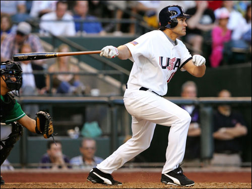 Outfielder Johnny Damon of Team USA hit a triple against Team Mexico during the Round 1 Pool B Game of the World Baseball Classic.