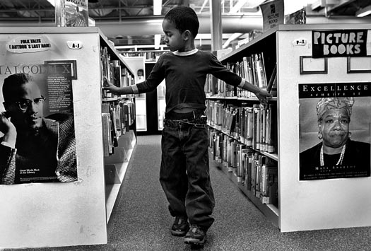 DORCHESTER -- If it takes a village to raise a child, the neighborhood library is an essential stop along the way. On a January morning, first grader Alonzo Robinson of the Emily A. Fifield Elementary School, browsed through the stacks at the Codman Square Branch of the Boston Public Library. His first-grade class comes regularly to the library. Principal Craig Lankhorst says the 10-minute walk to the local public library serves a dual purpose: literacy and exercise. Alonzo's teacher, Tricia Senier, says, 'My hope is that my students will recognize the library as a neighborhood place where they can go to enjoy books and study in a quiet, friendly, and safe environment.' (Globe Staff Photo / Suzanne Kreiter) audio: Click the play button below to hear Tricia Senier and her students choosing books <object classid='clsid:02BF25D5-8C17-4B23-BC80-D3488ABDDC6B' width='200' height='30' codebase= 'http://www.apple.com/qtactivex/qtplugin.cab'> (Audio by Scott LaPierre, Boston.com)