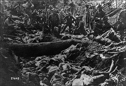 On March 7, 1906, US troops under the command of Major General Leonard Wood massacred as many as 1,000 Filipino Muslims, known as Moros, who were taking refuge at Bud Dajo, a volcanic crater on the island of Jolo in the southern Philippines. Above, US soldiers pose for the camera in the aftermath of the massacre.