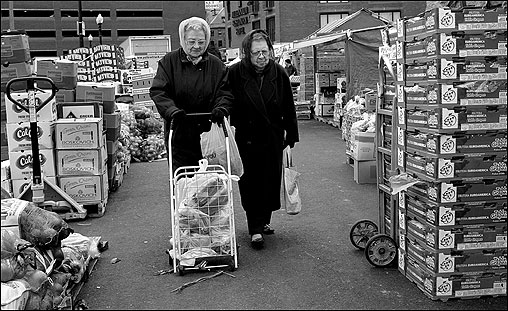 HAYMARKET -- Lucy, left, and Fannie Giarle are sisters in their nineties who were born and raised in the North End. Every other week, they make the 15-minute trip on foot to the Haymarket, which has provided inexpensive produce to city-dwellers from its open-air stalls since 1734. On this day, the Giarle sisters returned home with carrots, onions, pineapple, cabbage, escarole, lettuce, squash, and cucumbers. They buy whatever is in season and have been coming to the market on Blackstone Street since 1966, when their mother died and they took over the chore. ''I enjoy it, I really do,' said Fannie. 'I see all the new food and vegetables and I see all the people. When you get to my age, there&#146;s no more dancing.' (Globe Staff Photo / Suzanne Kreiter) audio: Click the play button below to hear photographer Suzanne Kreiter describe the scene at the Haymarket <object classid='clsid:02BF25D5-8C17-4B23-BC80-D3488ABDDC6B' width='200' height='30' codebase= 'http://www.apple.com/qtactivex/qtplugin.cab'> (Audio by Scott LaPierre, Boston.com)