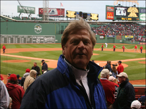 Dennis Drinkwater, president of Giant Glass and fixture in the front row behind home plate at Fenway, said he was going to 'cheer like crazy' when Johnny Damon stepped to the plate for the first time as a Yankee.