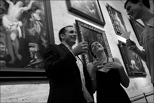 BOSTON -- On the first Friday of each month, a social scene unfolds amid the priceless collections of the Museum of Fine Arts. Though open to anyone over 21, 'mfafirstfridays' are attended mostly by young singles. On one recent Friday, while a samba band played, snippets of cocktail party banter could be heard in the Koch Gallery: 'I don't do blind dates.' 'I'm sorry I forgot your name.' 'Are you wearing Shalimar?' From left, John Abbruzzese, Julie Himmelwright, and Michael Terry, chatted under Bernardo Strozzi's 17th-century painting of St.Sebastian tended by St. Irene and Her Maid. Museum officials say they hope such events encourage young adults to return to the institution where they begin to explore the galleries and special exhibitions on their own. (Globe Staff Photo / Suzanne Kreiter) audio: Click the play button below to hear guests at a recent 'mfafirstfriday' <object classid='clsid:02BF25D5-8C17-4B23-BC80-D3488ABDDC6B' width='200' height='30' codebase= 'http://www.apple.com/qtactivex/qtplugin.cab'> (Audio by Scott LaPierre, Boston.com)