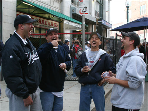 Yankees fans Brian and Keith Hunter, from Middletown, Conn., laugh it up with Red Sox fans Mike Mattingly, who says he is the fourth cousin of Yankees great Don Mattingly, and Pat Owen, no relation to Spike Owen, from Meriden, Conn. Brian said most of Conn. is comprised of Yankees fans and he referenced a Quinnipiac University survey that revealed 42 percent of people in Conn. are Yankees fans while 35 percent are Red Sox fans.