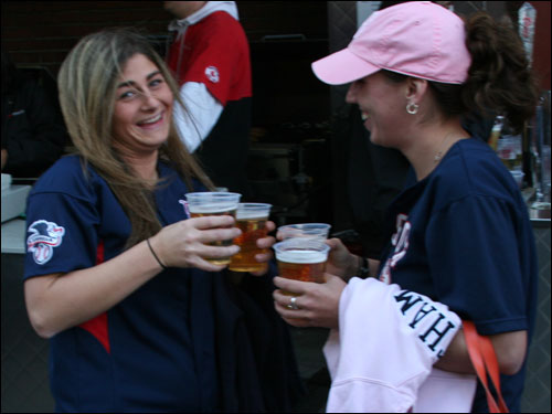 Sharon Toti (left) and Courtney Smith, both from Walpole, said the Yankees don't have anything left and are all finished for this season.