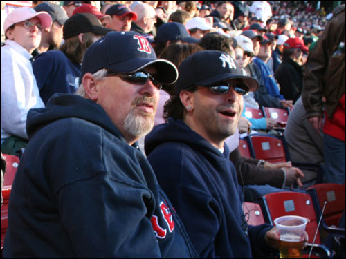 Roger Arsenault, from East Haven, Conn., has been a Red Sox fan his whole life, yet his son Frank, making his first trip to Fenway, is a lifelong Yankees fan. Roger made the switch to the Sox back in '61 when he saw his favorite player, Roger Maris, booed by the home crowd at Yankee Stadium. Frank is OK with that.