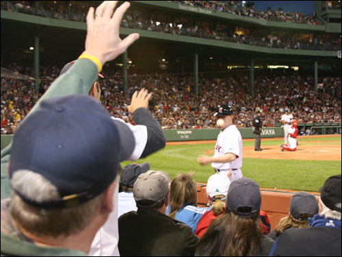 Another benefit of sitting right on top of the action in the lower box seats is that fans in the area always seem to get most of the foul ball souvenirs from the Fenway ball boys and girls.