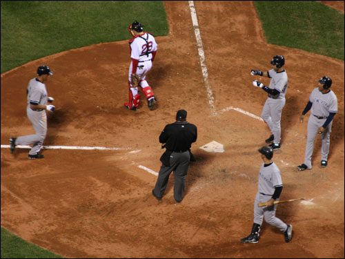 Alex Rodriguez (left) hit a three-run back breaking homer off Sox starter Tim Wakefield in the seventh inning, making the score 7-1 Yankees.