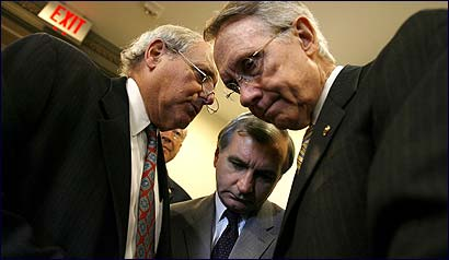 From left, Senators Carl Levin of Michigan, Jack Reed of Rhode Island, and Harry Reid of Nevada conferred before their news conference at the Capitol.