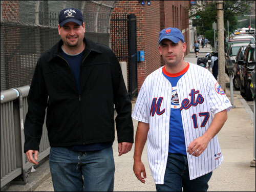 John Egan, in a Mets jersey, came to Boston from West Islip, NY, to take in the Sox-Mets hoopla at Fenway. John's cousin Tony DeChristopher from Brighton said tickets were going for $400 outside the park. Both predicted a postseason rematch of the '86 World Series. John thought Fenway fans would get on Pedro 'when they realize he's mowing them down.' He also predicted the Mets would end up taking two out of three games here.
