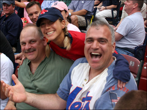 Firefighters Carl Buehler and Jack Yanuzzi, from Mamaroneck, NY, were at Fenway for the first time ever to see their beloved Mets. They didn't seem to mind that Medford's Nicole Rabideau and other Sox fans had them surrounded.