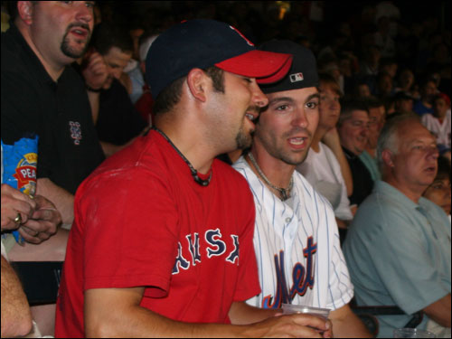 Norwood's Brian Woods and Neil Hanson are both Red Sox fans, but Neil decided to wear a Pedro Martinez shirt to honor the Mets ace. When asked how Pedro did in his return to Fenway, Neil replied, 'He got smoked.'
