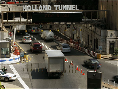 Police kept a close watch in New York City over the entrance to the Holland Tunnel, which connects Manhattan to New Jersey. A terror plot targeted PATH rail tunnels.