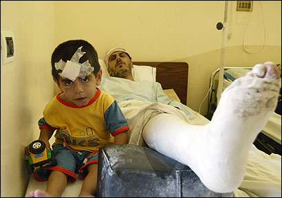 Khodor Kamaledine and his son Nabil lay in a hospital bed in Sarafand after they were wounded in an Israeli attack in Srifa, Lebanon. Fifteen houses in Srifa were flattened by Israeli airstrikes.
