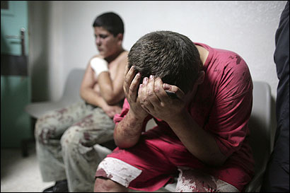 Two Lebanese civilians waited yesterday for further treatment at a hospital in Tyre in Southern Lebanon. Israel has ordered all 400,000 Lebanese people living south of the Litani river to flee.