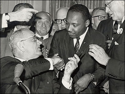 During his signing of the landmark Civil Rights Act of 1964, President Lyndon B. Johnson shook hands with the Rev. Martin Luther King Jr.