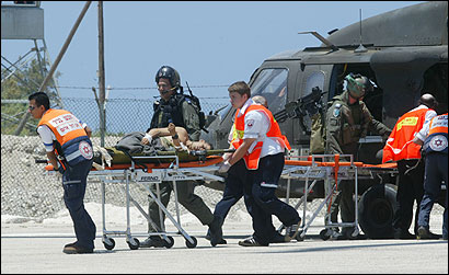 Injured Israeli soldiers arrived at a hospital in Haifa yesterday. Nine soldiers were killed and 25 wounded in fighting.