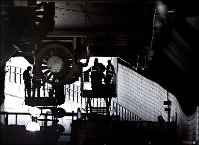 Crews worked on a ceiling fan yesterday inside the eastbound Ted Williams Tunnel. Governor Mitt Romney said during a press conference at the State House in Boston that work was also underway to shore up the fastening system holding up heavy fans.